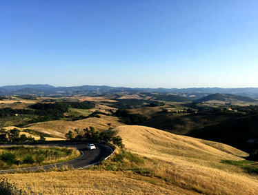 Private tours by minivan and English speaking driver guide to San Gimignano and Volterra